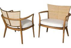 Pair of armchairs with rounded caned backs framed in bronze, rounded wood open arms and upholstered seat cushions, by Bert England for Johnson Furniture Co., American, 1950s.