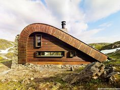 "Hunting lodge with a roof that ""grows out of"" landscape"