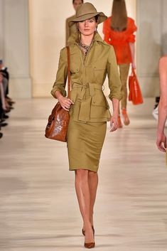 This outfit from the Ralph Lauren Spring 2015 Ready-to-Wear Collection Runway Show resembles the 1920's aesthetic. With the use of military color, trench coat, and hat covering one eye.