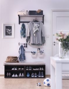 A low BESTÅ unit placed in your entryway makes a great bench for kids to take off their shoes and put them neatly away.