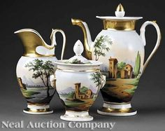 Paris Porcelain~Three piece coffee service~Painted with polychrome views of the Italian countryside scenes~Gilt embellishments~Consisting of a coffeepot Lidded sugar bowl~Milk pitcher~Gilt banded~Origin France~Circa 1840-1880