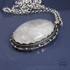 Extraordinary, big pendant with moonstone - hanged on a neck-chain. Handcrafted with sterling silver. Artfully done. The stone has visible