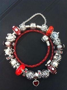 My new Alice in Wonderland (queen of hearts) themed Pandora bracelet.