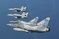 """French Armée de l'Air Mirage 2000-5 of the EC 1.2 « Cigognes » (""""Storks"""") and two Swiss Air Force F / A-18 C Hornet during 2009 @ Swiss Air Force"""