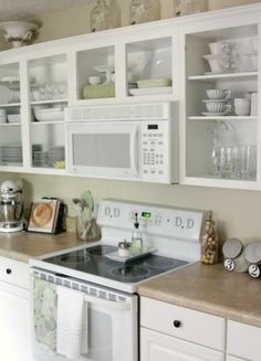 """I liked this idea for """"trying out"""" open shelving in the kitchen. Take off cabinet doors, caulk the holes, and you have open shelving to experiment with without committing a lot of money.  Love it!"""