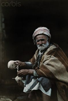 A elderly man spins yarn on the street in Palestine... God is patient. God is relentless. God I trust You. (6/3/13)