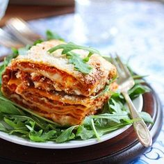 An Authentic Baked Lasagna: Thin layers of pasta sheets with Bolognese Sauce, Bechamel, Fontina, Parmigiano, and Mozzerlla di Bufala