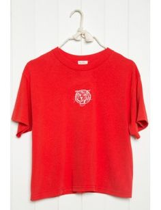 Red crewneck tee with a tiger embroidery in white.