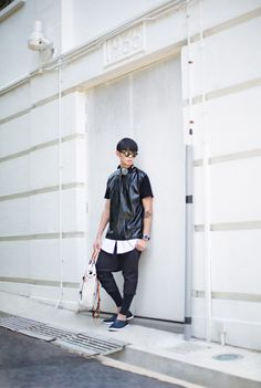 A feature of the QWSTION Daypack in Oyster Grey by: SHENTONISTA: CommonThread x: Street Kid On The Block, Melvin Lee, Works in Public Relations, Headphones from Urbanears, Sunglasses and Watch from Komono, Daypack bag from Qwstion, Shoes from Praiaz. #shentonista #theuniform #singapore #fashion #streetystyle #style #ootd #sgootd #ootdsg #wiwt #popular #people #male #menswear #sgstyle #cbd #urbanears #Komono, #Qwstion #Praiaz #daypack #Oystergrey #convertiblebag #leather #swissmade