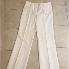 Trina Turk White Dress Pants Size 2 Never worn, some discoloration just from hanging up but a good dry cleaning will remove. These are too big and too long for me but super cute and I paid a good amount. Trina Turk Pants Wide Leg