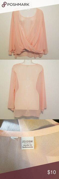 Ladies sheer peach blouse Ladies peach wrap flowy blouse. Plus Size 22/24 Excellent condition, no rips, stains or tears.  Designer tag has been removed as shown in pictures. Measurements are chest 26in and length from shoulder to bottom in 26inches with additional 3 inches in the back. Blouse is see through so a cami will be needed to go underneath. Tops Blouses