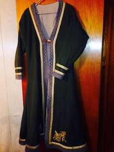 Wool and linen kaftan with tablet woven trim. By BadAss Garb