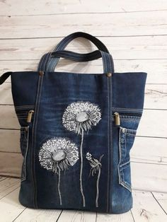 Denim bag accentuated with embroidery, lace and ribbon rosesconcept idea for denim bag Easier to paint than sew, howevBlue Bird in a winter scene.This Pin was discovered by SidTurn denim into a work of artvery interesting upcycled denim applique bag Denim Tote Bags, Denim Purse, Denim Bags From Jeans, Levis Jeans, Jean Purses, Purses And Bags, Diy Sac, Mode Jeans, Embroidery Bags