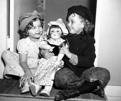 Ginette Marboeuf-Hoyet, known as the French Shirley Temple, presents the real Shirley with a doll, 1936.