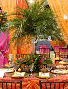 LOVE the palm leaves arrangement for a tropical party...