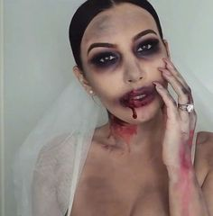 [Zombie bride-tutorial] This is a very messy look and also v. - Halloween[Zombie bride-tutorial] This is a very messy look and also very simple to do. The key is to not be very precise, which is a plus. You only need a white body paint, black, red Maquillage Halloween Zombie, Halloween Zombie Makeup, Zombie Make Up, Halloween Looks, Easy Halloween, Kids Zombie Makeup, Zombie Prom, Scary Makeup, Halloween Face