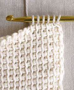 "Tunisian (also known as Afghan) crochet makes a beautifully textured, dense and squishy fabric. It's very easy to learn and very satisfying to hook up! This type of crochet is distinguished by the tool you use to work it, namely, a long ""Afghan"" hook. You should choose a size that is at least two sizes bigger then the hook you would normally use with the same yarn. Purl Soho has a selection of Afghan Crochet Hooks right here. Another characteristic of Tunisian Crochet is that yo..."