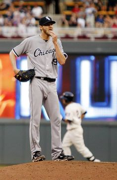 Chicago White Sox starting pitcher Chris Sale, foreground, reacts after giving up a three-run home run to Minnesota Twins' Brian Dozier (2) during the second inning of a baseball game on Wednesday, June 19, 2013, in Minneapolis. (AP Photo/Genevieve Ross)