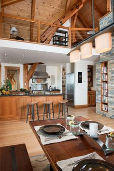 I like the use of rustic bricks and beams to contrast nicely with the clean walls and ceilings. J