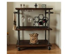 Industrial Kitchen Cart made with sturdy pipe legs and 2 push handles perfect for hanging towels, pots, pans or kitchen utensils from. 2 wood shelves with 4 industrial, locking casters to prevent cart from rolling while in use. **DIMENSIONS** Small: 18-24 long x 18 wide x 30 tall Medium: 18-35 long x 24 wide x 30 tall Large: 35-48 long x 24 wide x 30 tall **STAIN COLORS** Classic Gray Early American (pictured) Dark Walnut Ebony  **CASTERS/WHEELS** This item comes standard with (4) swivel…