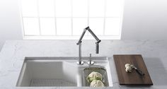 KOHLER | Kitchen Accessories | Kitchen - has a colander accessory that fits sink.  And how cool is that faucet.