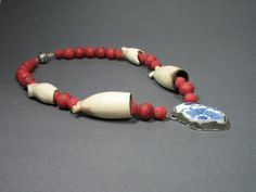 Dutch design jewelry  One of a kind necklace  Dutch design  handmade by me!  Delft's blue pottery shard, silver, coral and old pieces of clay pipes.  #design jewelry