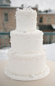 a white wedding cake with sugar pearls attached is ideal for a winter wonderland. - a white wedding cake with sugar pearls attached is ideal for a winter wonderland wedding - Wedding Cake Pearls, Wedding Cake Photos, White Wedding Cakes, All White Wedding, Wedding Cake Designs, Trendy Wedding, Snowflake Wedding Cake, Cake Wedding, Wedding Ideas