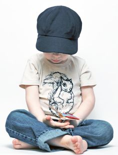 The drawing on this tee is a silk-screened version of an original drawing in thread using free-motion sewing! Love the picture. Love the tee!