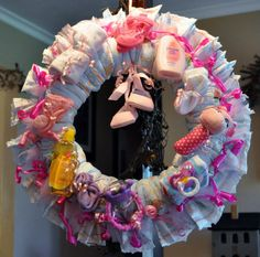 Another gorgeous diaper wreath!  I guess this is war of the diaper wreaths!  lol