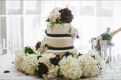 Beautiful, cheap, and simple. I loved my wedding cake! I love the white and dark purple hydrangeas.