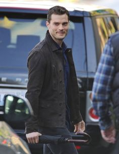 There's a smile!   The 57 Hottest Pictures of Jamie Dornan as Christian Grey   POPSUGAR Entertainment Photo 33