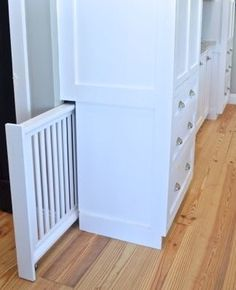 There are a lot of really great advantages to working with a cabinet builder. One of the biggest is customization. In many ways, the sky is the limit. (Assuming you can afford it.) In our case, our… house ideas Built-in hidden dog gate - NewlyWoodwards Home Design, Interior Design, Design Design, Urban Design, Interior Ideas, Modern Design, House Ideas, Dog Rooms, Dog Play Room