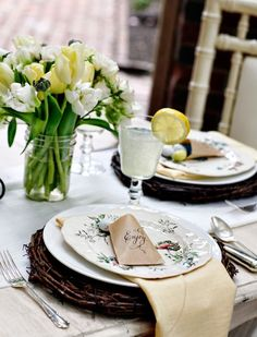 Easter table setting with vintage styled brown paper bag chocolate egg favours.