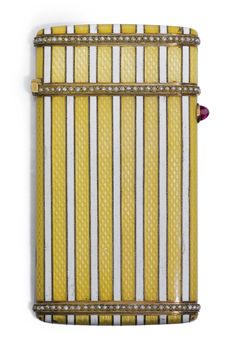 A FABERGÉ ENAMEL CARD CASE, MOSCOW, 1899-1908    the surface enamelled in alternating stripes of opaque white and translucent yellow over wavy engine-turning, the silver-gilt borders set with seed pearls, cabochon ruby thumbpiece, struck KF in Cyrillic,84 standard, scratched inventory number 25206  height: 8.5cm, 3 3/8 in.