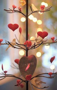 Valentines DayTable Centerpiece - Beautiful idea to cut a branch from a tree and make a tablescape. Add hanging felt or paper hearts.