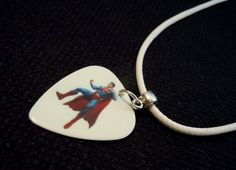 Superman Guitar Pick and White Rolled Leather Cord by ItsYourPick on Etsy