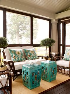 This super sunny porch/den incorporated the perfect pop of color with the Square Hook Garden Stools in Turquoise