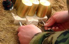 Inserting blasting caps into blocks of C4 explosive