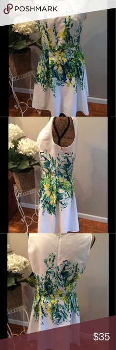 "Beautiful Floral Summer Dress Like new, excellent condition! Studio One New York size 10 dress. Sleeveless and cool for summer! White with green, blue, yellow shades of flowers in middle section of dress. Back zipper. Length 36"" from back neckline, waist 31 1/2"", bust 39 1/2"". Machine wash cold. 97% cotton, 3% spandex. Top lining with 100% polyester. Studio One New York Dresses Midi"
