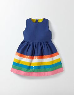 We've found the end of the rainbow and sewn it onto this pretty dress. With a twirl-worthy skirt and added sequins, it's always ready for a party. A zip fastening at the back makes it easy to get on and the durable cotton poplin is comfortable to wear.