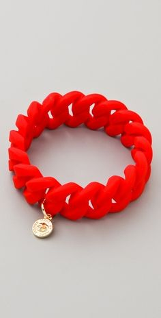 Marc by Marc Jacobs Rubber Turnlock Bracelet in Shock Red.