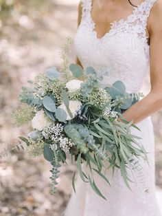 15 Cascading Wedding Bouquets for Every Style These sweeping streams of blooms add drama and personality to any wedding day look. Take a look at 15 cascading wedding bouquets for every style. Cascading Wedding Bouquets, Summer Wedding Bouquets, Diy Wedding Bouquet, Wedding Flower Arrangements, Bride Bouquets, Wedding Dresses, Spring Wedding, Flower Bouquets, Wedding Flower Guide