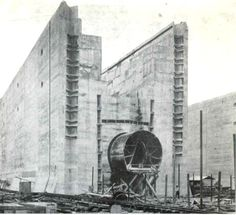 The Middle Wall of the Gatun Locks (The size of the structure can be appreciated by noting the man at the bottom. The great cylinder is the culvert to fill or empty the locks. Panama Canal, Panama City Panama, Countries In Central America, City Pages, Hoover Dam, South Of The Border, Building Structure, Black And White Pictures, Under Construction