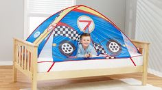 If your child loves cars, they'll adore this super-cool instant fort. It transforms any twin bed into a fun, comfy play space when weather (or feeling under the weather) keeps the kids indoors. #cars #racecar #tent #brightideas #giftsforkids