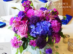 The centerpieces included Hydrangea, Roses, Lisianthus, Dahlias and Mokara Orchids in varying vases and footed bowls. © Andrew's Garden, Inc.
