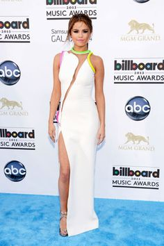 Selena Gomez lit up the #redcarpet in this neon-accented Atelier Versace Spring 2013 dress!  #Billboard2013