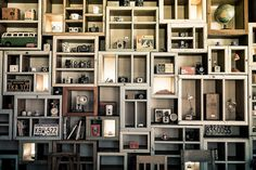 An awesome way to display a vintage camera collection. Shelves, shelves and more shelves.
