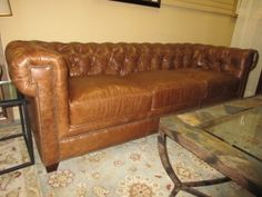 """Leather Verona Sofa Price: $1499.99  Item #: 41178 How English!  Scrumptious Chesterfield tufted top grain leather sofa outlined with traditional nail head trim.  Its 94"""" long, 39"""" deep and 31"""" tall."""