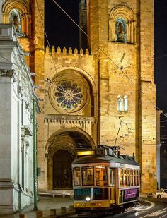 The tram passing by the Medieaval Cathedral Lisbon #Portugal see more about Portugal and Lisbon in Enjoy Portugal website: http://www.enjoyportugal.eu/#!lisboa/cjbl