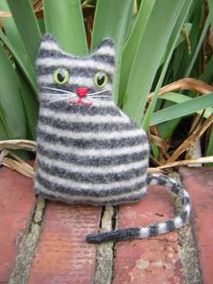 felt cat  (Take an old sweater,make a pattern and help your child sew it and stuff it)!